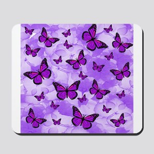 PURPLE FLOWERS AND BUTTERFLIES Mousepad